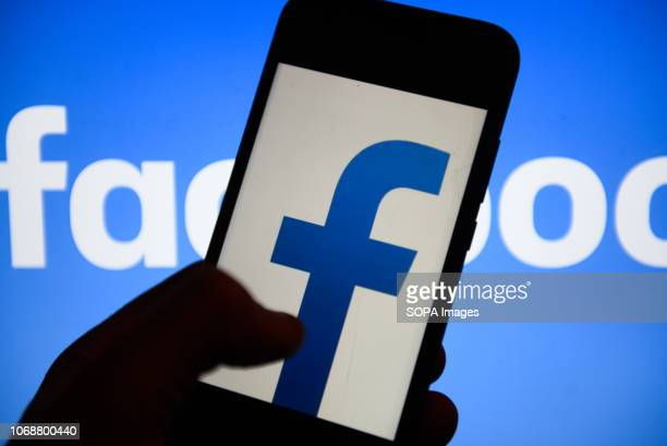 In this photo illustration the Facebook logo is seen displayed on an Android mobile phone