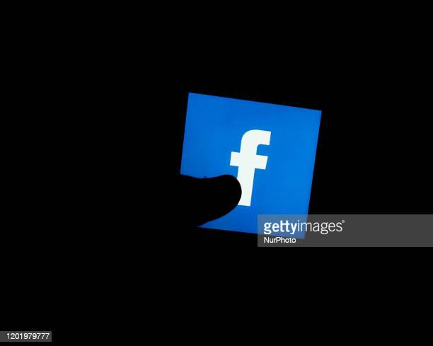 In this photo illustration the Facebook logo is seen displayed on smartphone screen in London , on 20 February 2020.