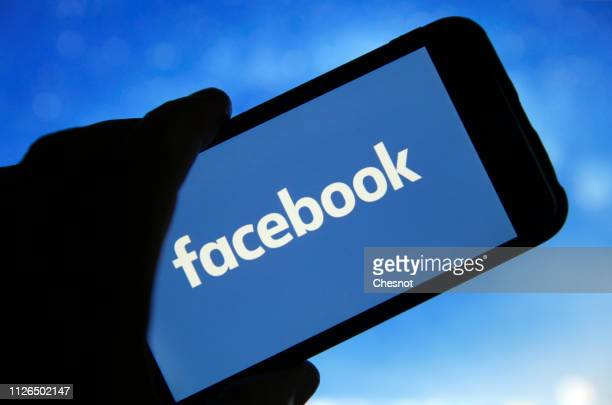 In this photo illustration the Facebook logo is seen on the screen of an iPhone on January 31 2019 in Paris France The social media Facebook revealed...