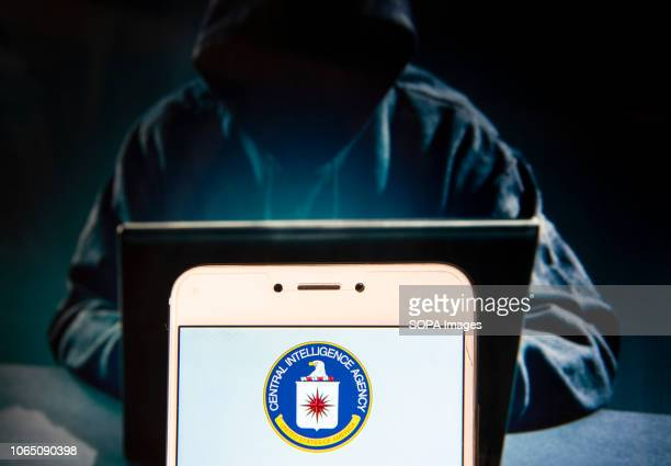 In this photo illustration, the Federal government of the United States and civilian foreign intelligence service, The Central Intelligence Agency ,...