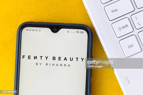 In this photo illustration the Fenty Beauty by Rihanna logo seen displayed on a smartphone.