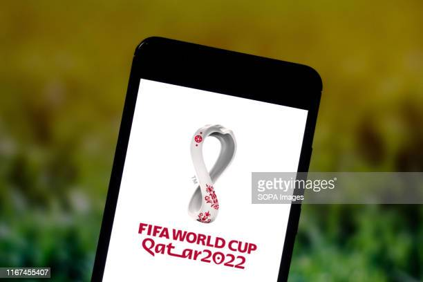 In this photo illustration the FIFA World Cup Qatar 2022 logo is seen displayed on a smartphone.