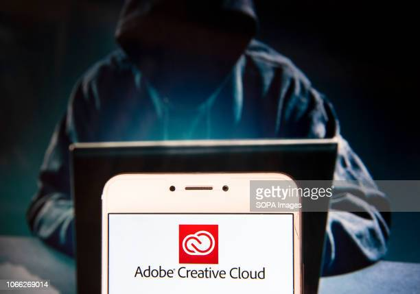 File hosting service and computer software access owned by Adobe Systems Adobe Creative Cloud logo is seen on an Android mobile device with a figure...