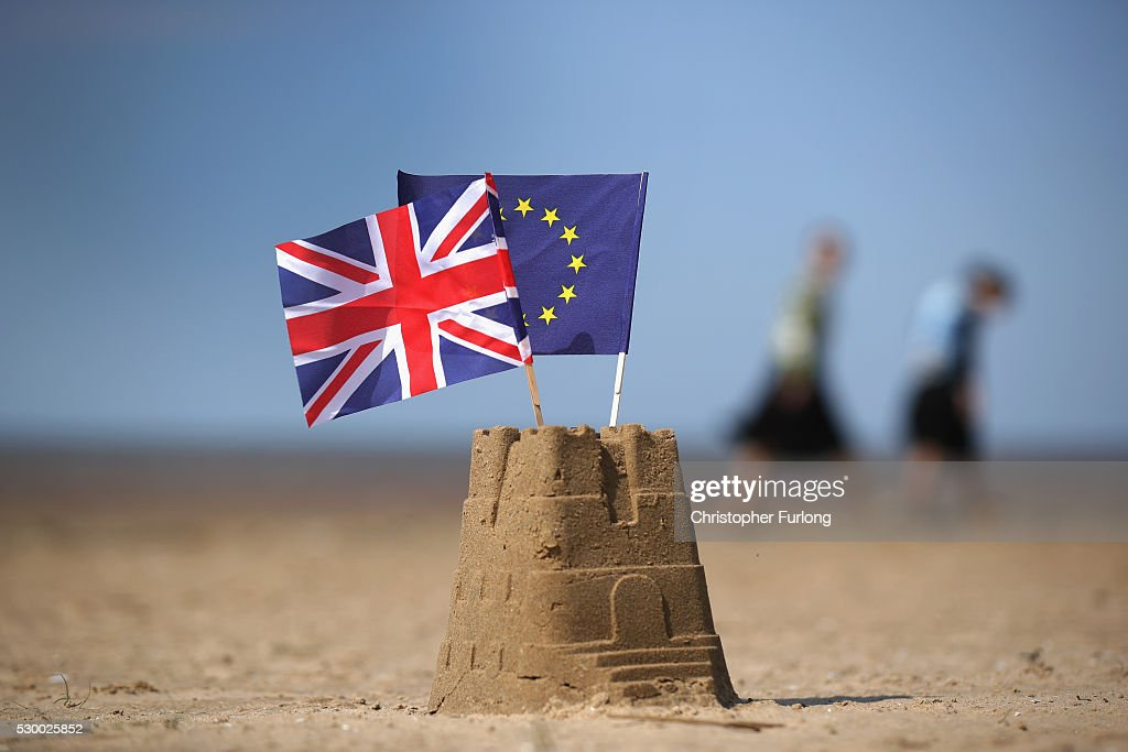 In this photo illustration the flag of the European Union and the Union flag sit on top of a sand castle on a beach on May 09, 2016 in Southport, United Kingdom. The United Kingdom will hold a referendum on June 23, 2016 to decide whether or not to remain a member of the European Union (EU), an economic and political partnership involving 28 European countries which allows members to trade together in a single market and free movement across it's borders for cirtizens.