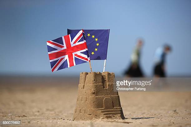 In this photo illustration the flag of the European Union and the Union flag sit on top of a sand castle on a beach on May 09, 2016 in Southport,...