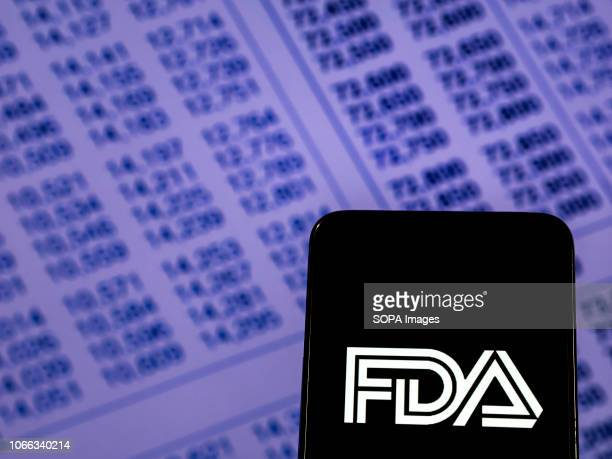 In this photo illustration the Food and Drug Administration Federal agency logo seen displayed on a smartphone