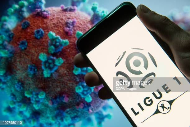 In this photo illustration the French football professional division Ligue 1 logo seen displayed on a smartphone with a computer model of the...