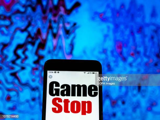 In this photo illustration the GameStop Electronics retail company logo seen displayed on a smartphone