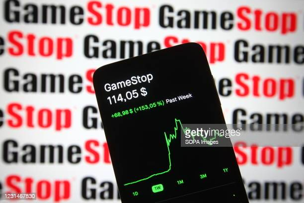 In this photo illustration the GameStop stock price and a chart are seen on a smartphone screen.