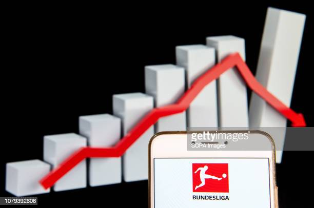 In this photo illustration, the German professional association football league Bundesliga logo is seen displayed on an Android mobile device with a...