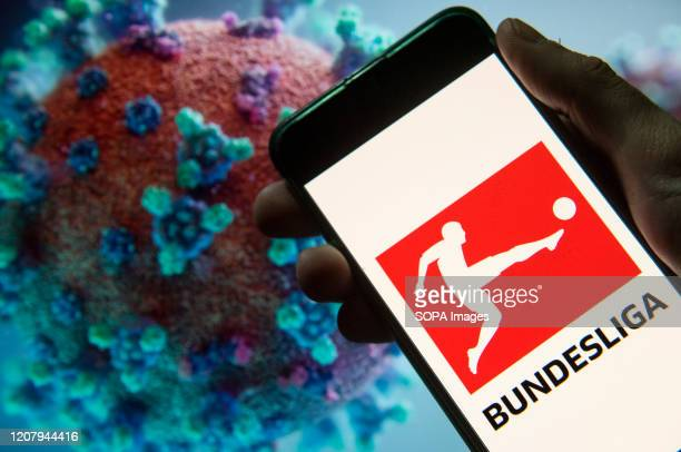 In this photo illustration the German professional association football league Bundesliga logo seen displayed on a smartphone with a computer model...