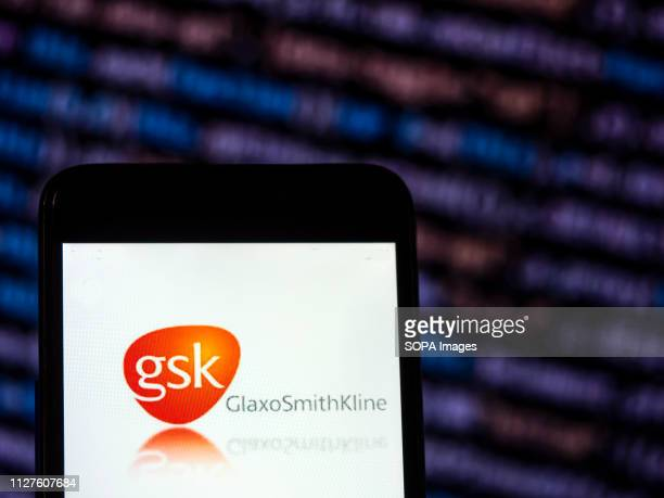In this photo illustration the GlaxoSmithKline Pharmaceutical company logo seen displayed on a smartphone