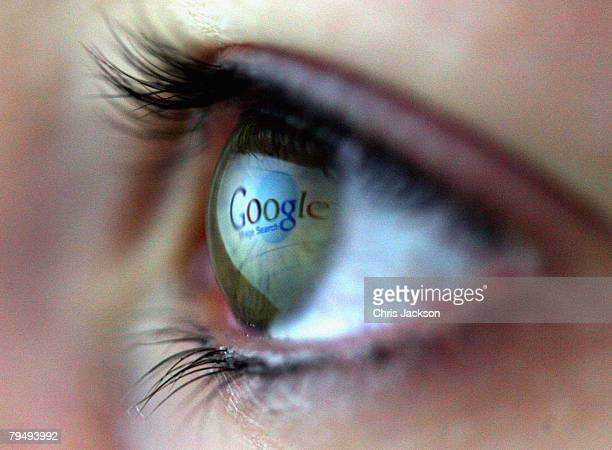 In this photo illustration the Google logo is reflected in the eye of a girl on February 3, 2008 in London, England. Financial experts continue to...