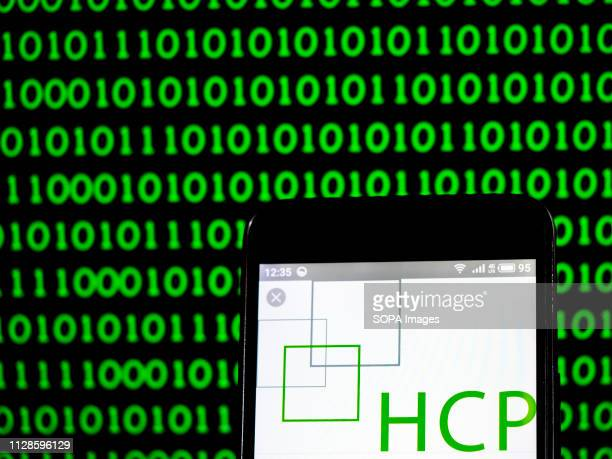 In this photo illustration the HCP Inc formerly Healthcare Property Investors Inc Real Estate Investment Trust logo seen displayed on a smartphone