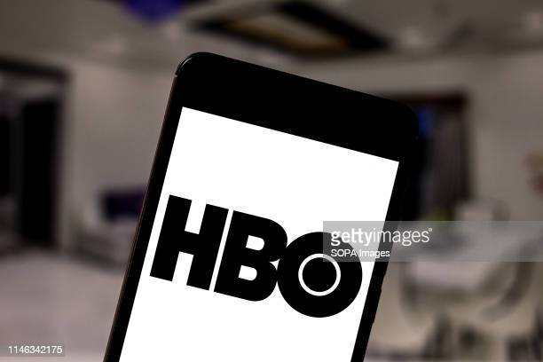 In this photo illustration the Home Box Office logo is seen displayed on a smartphone