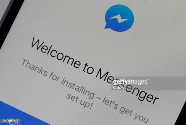 In this photo illustration the home page of the instant messenger 'Messenger' is seen on the screen of an iPhone on April 06 2018 in Paris Messenger...