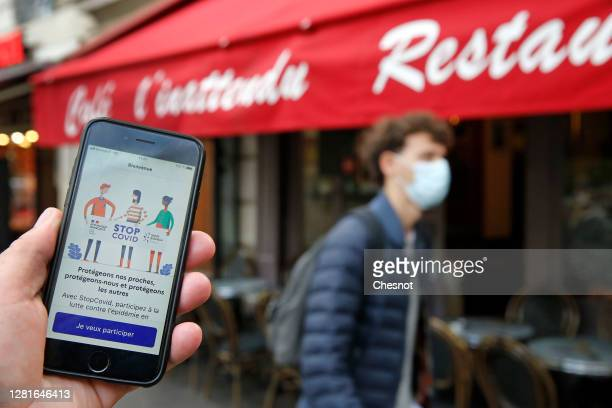"""In this photo illustration, the home page of the new French mobile phone application """" Tous Anti-Covid """", developed to track people who have tested..."""