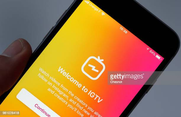 In this photo illustration the homepage of the IGTV application is displayed on the screen of an Apple iPhone on June 22 2018 in Paris France...