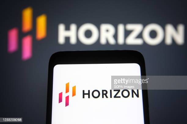 In this photo illustration the Horizon Therapeutics logo of a biopharmaceutical company is seen on a smartphone and a pc screen.