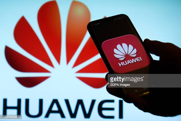 In this photo illustration the Huawei logo is seen displayed on an Android mobile phone