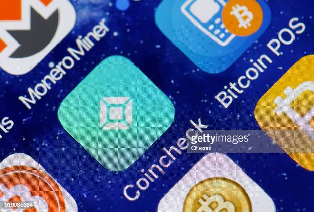 In this photo illustration the icon of the the Coincheck cryptocurrency exchange application is seen on the screen of an iPhone on February 16 2018...