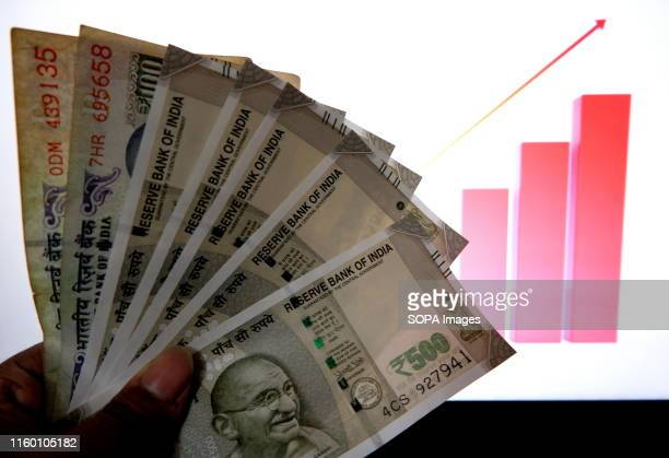 In this photo illustration the Indian currency notes are seen on display Dollar price made its highest peak against the Indian rupee this week