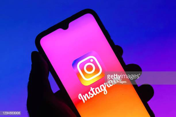 In this photo illustration the Instagram logo seen displayed on a smartphone.