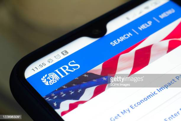 In this photo illustration the Internal Revenue Service logo seen displayed on a smartphone.