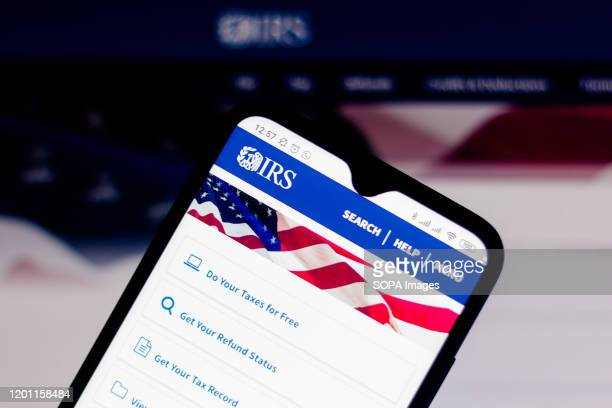 In this photo illustration the Internal Revenue Service website seen displayed on a smartphone.