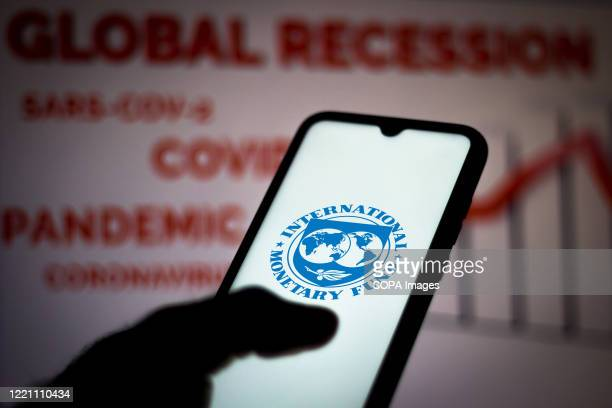 In this photo illustration the International Monetary Fund logo seen displayed on a smartphone.