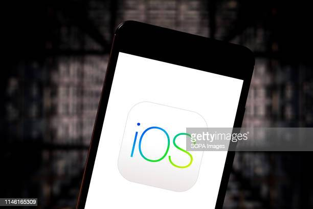 In this photo illustration the iOS logo is seen displayed on a smartphone