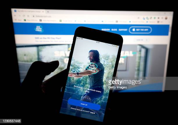 In this photo illustration, the Joe Wicks aka 'The Body Coach' fitness app is seen on a mobile phone on January 11, 2021 in London, United Kingdom.