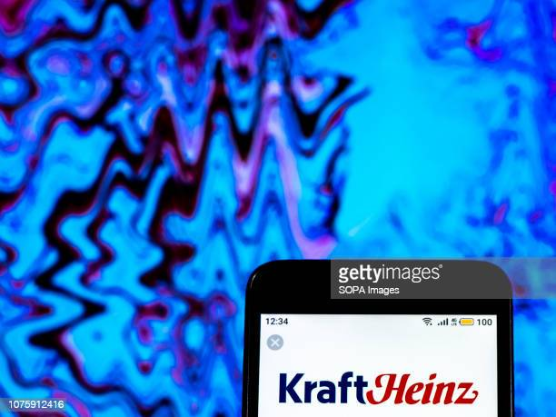 In this photo illustration the Kraft Heinz Company logo seen displayed on a smartphone