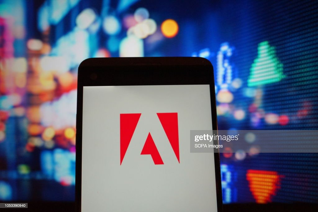 The logo of  Adobe is seen in a smartphone : News Photo