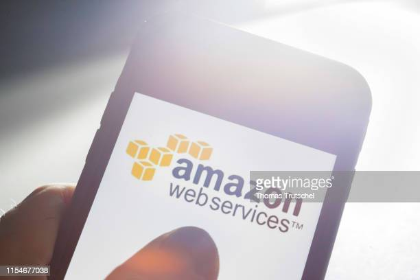In this photo illustration the Logo of Amazon Web Services is displayed on a smartphone on July 09, 2019 in Berlin, Germany.