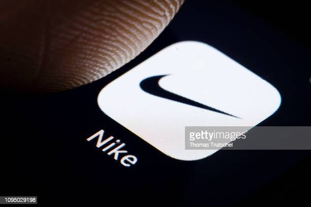 In this photo illustration the logo of American marketer of athletic shoes, apparel, and sports equipment Nike is displayed on a smartphone on...