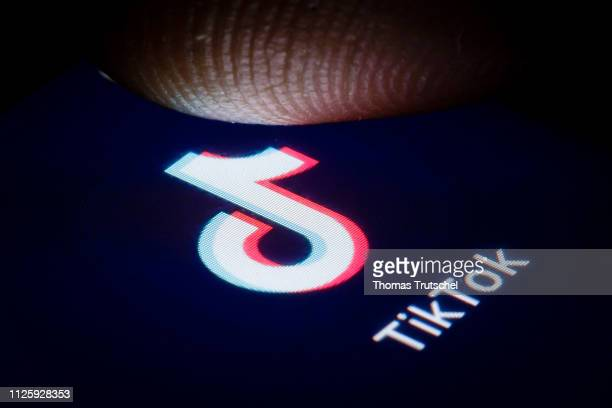 In this photo illustration the logo of chinese media app for creating and sharing short videos TikTok also known as Douyin is displayed on a...