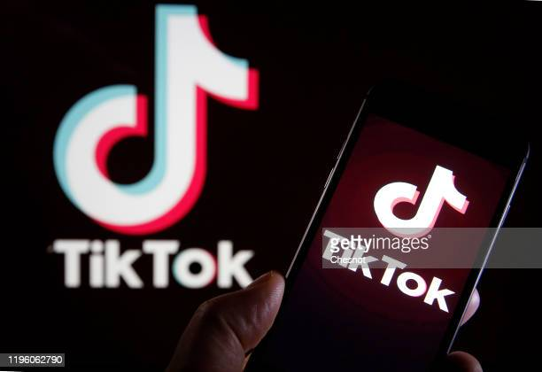 In this photo illustration the logo of Chinese media app for creating and sharing short videos,TikTok, also known as Douyin is displayed on the...