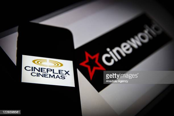 In this photo illustration the logo of Cineworld is displayed on a laptop screen and the logo of Cineplex is displayed on a smart phone screen in...