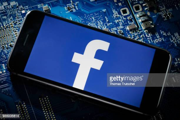 In this photo illustration the logo of Facebook is displayed on a smartphone which is lying on a circuit board on March 20 2018 in Berlin Germany