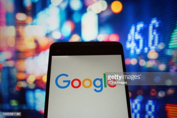 In this photo illustration the logo of google is seen displayed on a smartphone