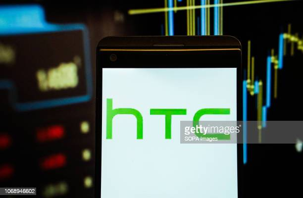 In this photo illustration the logo of HTC is seen displayed on a smartphone