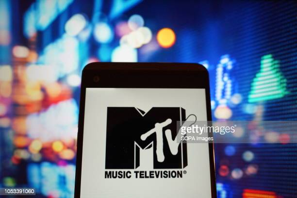 The logo of music television is seen in a smartphone