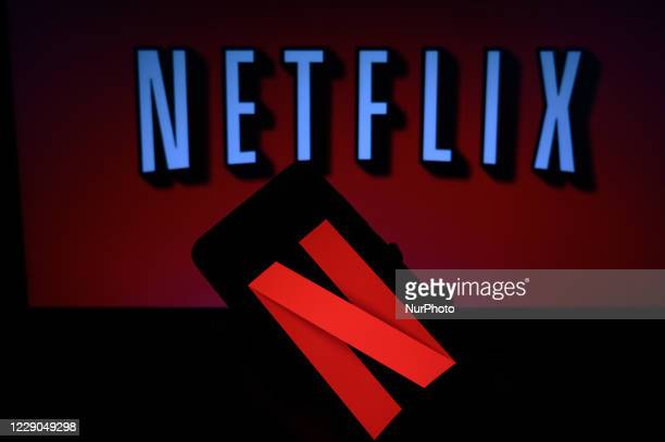 In this photo illustration, the logo of Netflix is displayed on a laptop screen and on a smart phone screen in Tehatta, Nadia, West Bengal, India on...