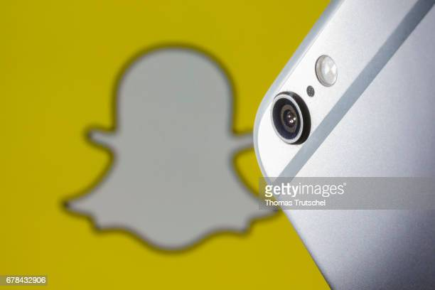 In this photo illustration the logo of Snapchat is displayed behind the camera lens of a smartphone on May 04 2017 in Berlin Germany