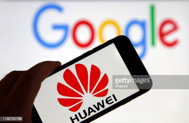 In this photo illustration the logo of the Chinese company Huawei is displayed on the screen of a mobile phone in front of a computer screen...