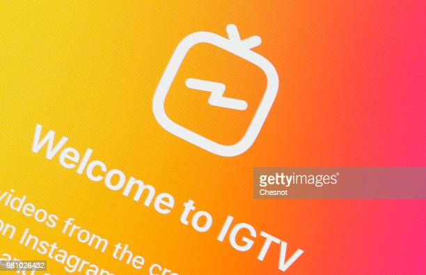 In this photo illustration the logo of the IGTV application is displayed on the screen of an Apple iPhone on June 22 2018 in Paris France Instagram...