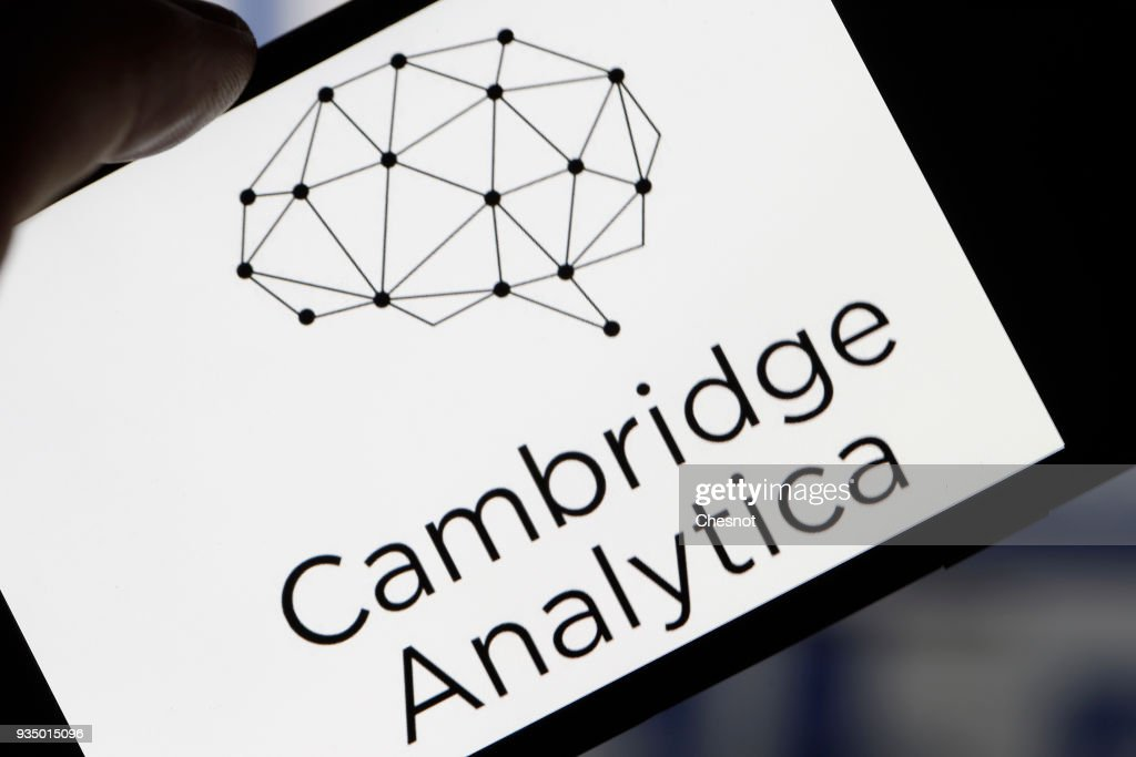 In this photo illustration the logo of the strategic communication company 'Cambridge Analytica' is seen on the screen of an iPhone on March 20, 2018 in Paris, France. Cambridge Analytica is accused of collecting the personal information of 50 million users of the Facebook social network without their consent and would have used it to develop software to predict and influence voter voting during the campaign American election according to the New York Times and the Guardian. Facebook share price fell by more than 5% Monday shortly after the opening of Wall Street.