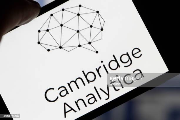 In this photo illustration the logo of the strategic communication company 'Cambridge Analytica' is seen on the screen of an iPhone on March 20 2018...