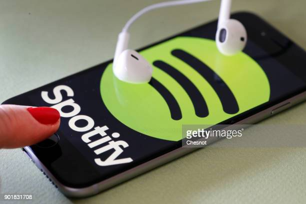 In this photo illustration the logo of the Swedish music streaming service Spotify is displayed on the screen of an iPhone on January 06 2017 in...